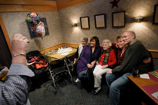 """Record-Eagle/Keith King<br /> A photo is taken of Doris Brackett, of Traverse City, Saturday, January 21, 2012 as she sits with her daughter, Gen Oberpeul, far left, of Bellaire, her granddaughter, Peggy Ellibee, second from left, of Traverse City, granddaughter, Patricia Schram, second from right, of Traverse City, and grandson, Ron Schuknecht, far right, of Traverse City, during Brackett's birthday celebration lunch at the Traverse City Elks Lodge which was attended by family members and close friends. Brackett turned 108-years-old on Friday, January 20. She was born on January 20, 1904 in Monroe County, Michigan. She is a huge fan of the Detroit Red Wings and Detroit Tigers and enjoys crossword puzzles. Brackett worked in accounting for a bit and volunteered at the Traverse City Convention and Visitors Bureau until she was 100. """"She's still a whiz with numbers; she won't use a calculator,"""" Chuck Ellibee, Brackett's grandson-in-law, said. When the Detroit Red Wings play a game on the west coast, Brackett will take a nap so that she's able to stay up later and watch the game.  Brackett attributes her longevity to """"being around good people and having good friends."""""""