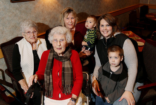 "Record-Eagle/Keith King<br /> Doris Brackett, front left, of Traverse City, sits with her daughter, Gen Oberpeul, in back from left, of Bellaire, granddaughter Patricia Schram,  of Traverse City, great-great grandson Greyson Cano, 1, of Traverse City, great-granddaughter Kristen Cano, of Traverse City and great-great-grandson, Jaxsen Cano, 4, of Traverse City Saturday, January 21, 2012 during Brackett's birthday celebration lunch at the Traverse City Elks Lodge which was attended by family members and close friends. Brackett turned 108-years-old on Friday, January 20. She was born on January 20, 1904 in Monroe County, Michigan. She is a huge fan of the Detroit Red Wings and Detroit Tigers and enjoys crossword puzzles. Brackett worked in accounting for a bit and volunteered at the Traverse City Convention and Visitors Bureau until she was 100. ""She's still a whiz with numbers; she won't use a calculator,"" Chuck Ellibee, Brackett's grandson-in-law, said. When the Detroit Red Wings play a game on the west coast, Brackett will take a nap so that she's able to stay up later and watch the game.  Brackett attributes her longevity to ""being around good people and having good friends."""