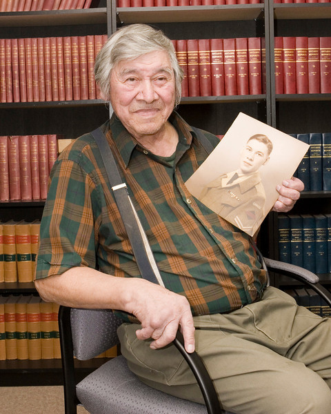 Jack Wynne, World War II veteran from the Moose Cree First Nation who attended the Double M Pow-Wow in Feburary 2009, shown here holding a wartime portrait of himself