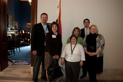 L-R:  Jeffrey Pomranka, Chief Operating Officer (DSAGSL);   Lynn Neidigh, President Down Syndrome Group of the Ozarks, MO (DSGO); Megan Layton, Self Advocate & Board Member (DSAGSL);  Christy Klaus, New Parent Support Coordinator (DSAGSL); Staff from Sen Kit Bond's Office (unknown man  & Julie Jolly)