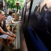 "Lena Crist, left, and her twin brother, Landon, of Niwot, look over the photography of Mike David at the art fair on Saturday.<br /> The 32nd Annual  Downtown Boulder ArtFair continues Sunday fro 10 a.m. to 5 p.m. on the Pearl Street Mall.<br /> For more photos and a video of the fair, go to  <a href=""http://www.dailycamera.com"">http://www.dailycamera.com</a>.<br />  Cliff Grassmick / July 17, 2010"