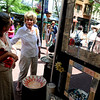 "Claire Pousson, left, of Bluehaven Porcelain, helps Pat Garcia at her booth on Saturday.<br /> The 32nd Annual  Downtown Boulder ArtFair continues Sunday fro 10 a.m. to 5 p.m. on the Pearl Street Mall.<br /> For more photos and a video of the fair, go to  <a href=""http://www.dailycamera.com"">http://www.dailycamera.com</a>.<br />  Cliff Grassmick / July 17, 2010"
