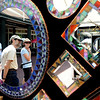 "People look at the mirror  work of Randy and Terry Romanin of Conifer, CO.<br /> The 32nd Annual  Downtown Boulder ArtFair continues Sunday fro 10 a.m. to 5 p.m. on the Pearl Street Mall.<br /> For more photos and a video of the fair, go to  <a href=""http://www.dailycamera.com"">http://www.dailycamera.com</a>.<br />  Cliff Grassmick / July 17, 2010"