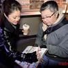 Kristi Yamaguchi signs a calendar for a fan