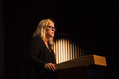 Dr. Amy Bass lectures on Dever Stage at Westfield State University, October 2016