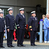 Dracut 9-11 ceremony at Jones Ave fire station. Dracut Fire Department members, left, and John Ogonowski's sister Carol Ogonowski, and his uncle Al Ogonowski, both of Dracut. (SUN/Julia Malakie)