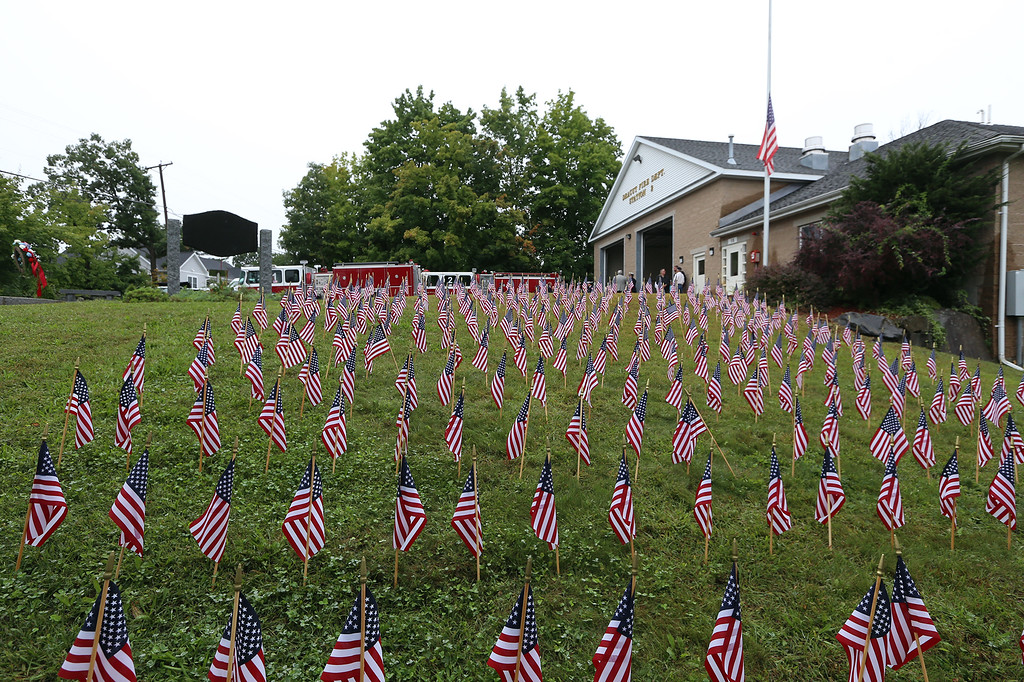 . Flag at half-staff after Dracut 9-11 ceremony at Jones Ave fire station. (SUN/Julia Malakie)