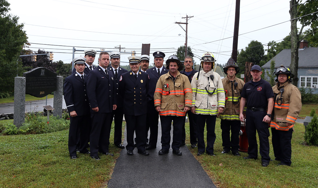 . Members of the Dracut Fire Department pose for a photo after the Dracut 9-11 ceremony at Jones Ave fire station. (SUN/Julia Malakie)