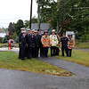 Ellie Richardson of Dracut takes a picture of members of the Dracut Fire Department after the Dracut 9-11 ceremony at Jones Ave fire station. (SUN/Julia Malakie)