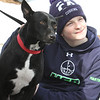 Dracut Open Space Committee holds 6th annual birthday walk to celebrate the 318th anniversary of Dracut's separation from the town of Chelmsford on Feb 26, 1701, ending with refreshments on Brentwood Drive. Corbin Martin, 13, of Dracut, with Mookie, a one-year-old rescue dog who belongs to Open Space Committee member Bill Greenwood. (SUN Julia Malakie)