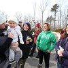 Dracut Open Space Committee holds 6th annual birthday walk to celebrate the 318th anniversary of Dracut's separation from the town of Chelmsford on Feb 26, 1701, ending with refreshments on Brentwood Drive. From left, Kaci Brown of Nashua with daughter Olivia, 1, her mother Karen Merrill of Dracut, who's on the Open Space Committee, Natalene Gorfine of Pelham, Colleen Barclay of Dracut, also on the Open Space Committee. (SUN Julia Malakie)