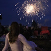 Annual concert and fireworks at Dracut school complex. Mary Cunningham and stepson Travis Kosiavelon, 6, of Lowell, watch the fireworks. (SUN/Julia Malakie)