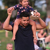 Annual concert and fireworks at Dracut school complex. Jorge Valle of Dracut and daughter Natalie Valle, 4, enjoy the music. (SUN/Julia Malakie)