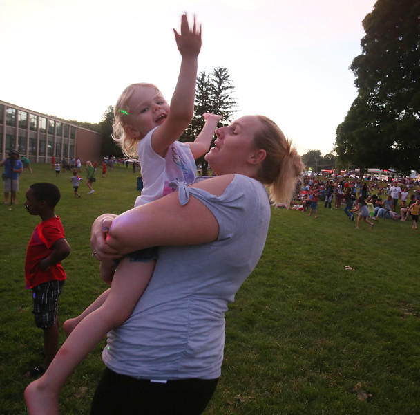 Annual concert and fireworks at Dracut school complex. Kitara Mason of Nashua with daughter Sydney Maille, 3. (SUN/Julia Malakie)