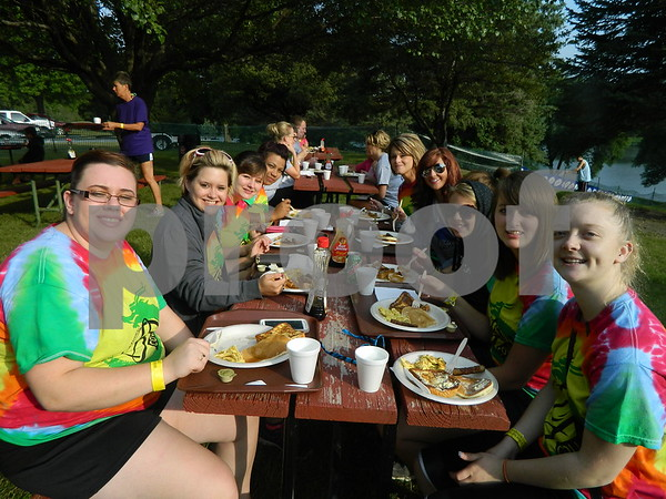 Left to right: Jessica Berger, Megan Kunz, Brittney Smith, Tamisha Benedict, Tammy Gargano, Olivia Key, Kandace Sorenson, Megan Anderson, and Sarah Gruhn all part of the lajames international college team eating some breakfast before they head out and compete on the water.