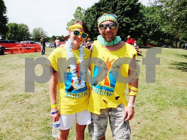 Jess Barkhaus and Josh Pavik with the dragon boat race team Castaways.