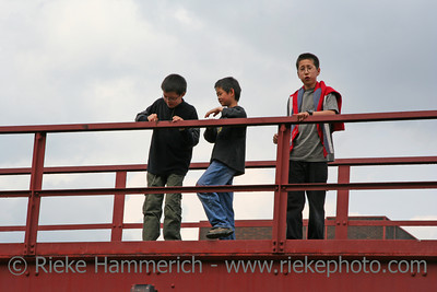 chinese boys on a bridge