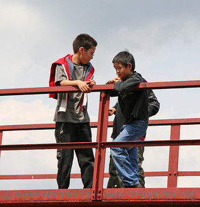 chinese boys on a red bridge