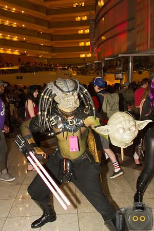 Predator Cosplay at Dragoncon 2015 holding a Yoda head
