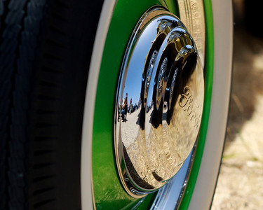 Triple layer reflection in hubcaps.