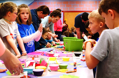Debbie Blank | The Herald-Tribune Students use colorful cupcake liners to create dragons, one of a handful of stations in the BPS cafeteria.