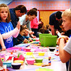 Debbie Blank | The Herald-Tribune<br /> Students use colorful cupcake liners to create dragons, one of a handful of stations in the BPS cafeteria.