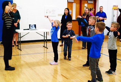 Debbie Blank   The Herald-Tribune A teacher leads children in tai chi, a relaxing form of exercise.