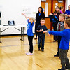 Debbie Blank | The Herald-Tribune<br /> A teacher leads children in tai chi, a relaxing form of exercise.