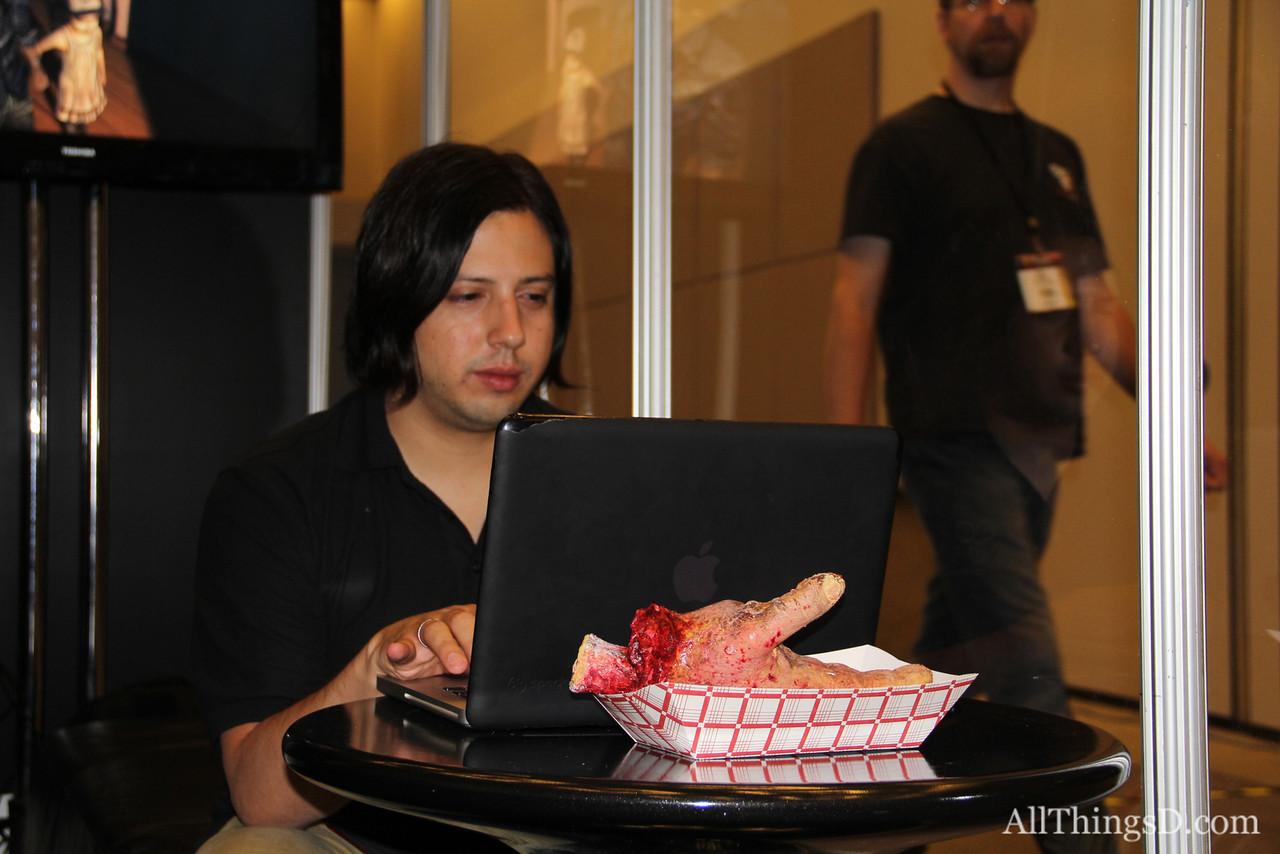 A gamer enjoys a hearty snack.