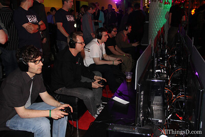 Gamers get gaming at the Xbox Live party.