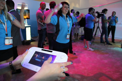 The Wii U GamePad controls some of the gaming action on your TV screen.
