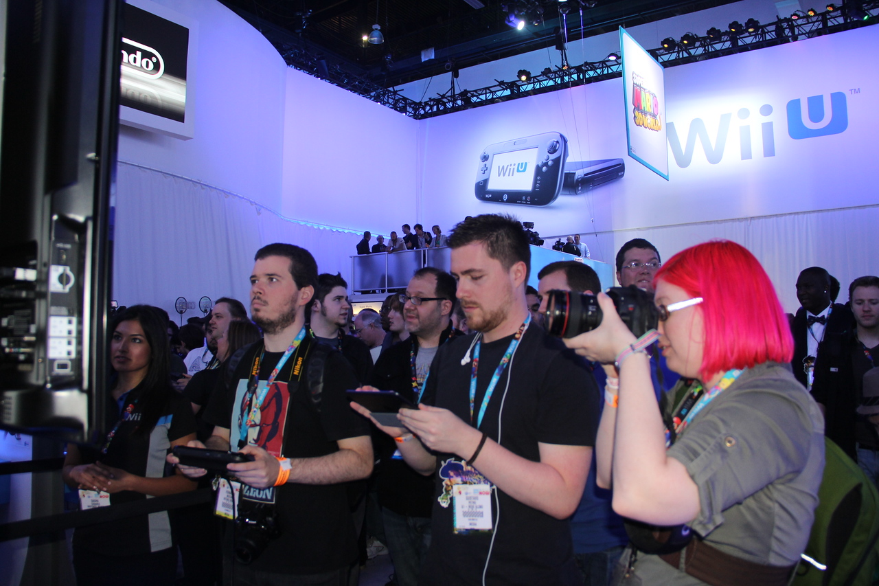 Gamers play the Wii U. Photographer does exactly what I'm doing.