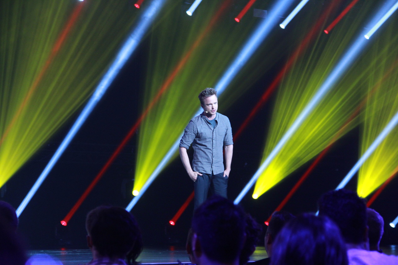 "Aaron Paul, a.k.a. Jesse Pinkman of ""Breaking Bad,"" appears on stage at the Electronic Arts press conference to promote ""Need for Speed."""