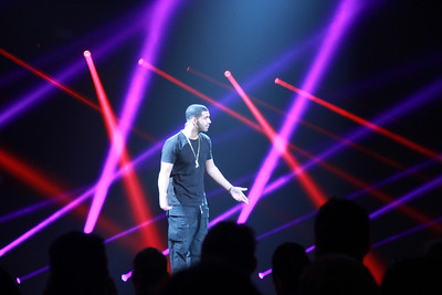 Rapper and entertainer Drake shows up to promote the upcoming FIFA 14. We don't even know if he likes soccer, but one thing's for sure: EA likes to roll out the celebrities.