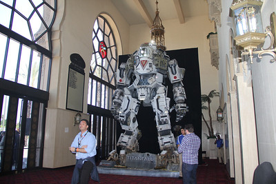 A stompy robot from Titanfall takes over the Shrine Auditorium, home of many Hollywood awards shows. We think he's trying to one-up the Angie's Right Leg meme.