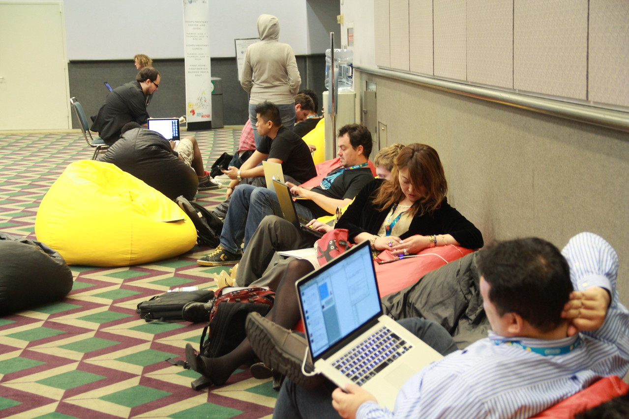 Reporters and bloggers hang out on bean bags in the press room at E3.