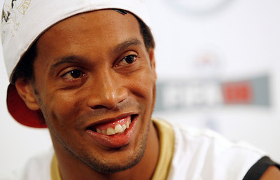Barcelona's soccer player Ronaldinho attends a news conference before capture filming for a new videogame in Barcelona, May 24, 2007. REUTERS/Albert Gea (SPAIN)
