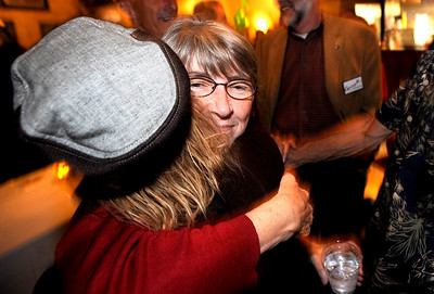 1104ELECT4.JPG City Council member Suzy Ageton (cq)(right) gets a hug from Jodee Siff , Barry Siff's wife, during an election party at the Boulder Draft House in Boulder, Colorado November 3, 2009. CAMERA/Mark Leffingwell