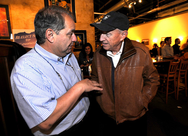1104ELECT2.JPG Newly elected City Council member George Karakehian (cq)(left) talks with Senator Rollie Heath (cq)(right) during an election night party at the Boulder Draft House in Boulder, Colorado November 3, 2009. CAMERA/Mark Leffingwell