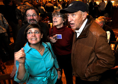 1104ELECT3.JPG Out going City Council member Angelique Espinoza (cq)(front), current Council member Ken Wilson (cq)(back left), Council member Suzy Ageton (cq)(center) and Senator Rollie Heath (cq)(right) watch the election results at the Boulder Draft House in Boulder, Colorado November 3, 2009. CAMERA/Mark Leffingwell
