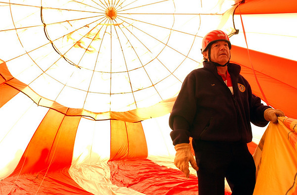 N0520BALLOON224.JPG<br /> <br /> Pilot Jon Seay from Lakewood takes a look from the inside out as prepares to launch his balloon Big Top as around 60 hot air balloons get ready to rise into the sky as part of the Erie Town Fair on Saturday May 19, 2007 on the grounds of the Vista Ridge Golf Club.  If you missed the launch you can see another launch starting at 6 am on Sunday.<br /> Photo by Paul Aiken / The Camera / May 19, 2007