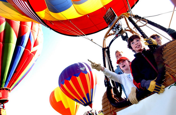 N0520BALLOON246.JPG<br /> <br /> Twins Brianna and Dylan Larkin of Erie look in awe as they rise into the sky with around 60 hot air balloons as part of the Erie Town Fair on Saturday May 19, 2007.  Pilot Roxie Arnold of Cheyenne Wyoming was taking them into the sky. If you missed the launch you can see another launch starting at 6 am on Sunday on the grounds of the Vista Ridge Golf Club. <br /> Photo by Paul Aiken / The Camera / May 19, 2007