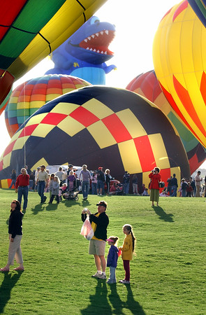 N0520BALLOON219.JPG<br /> <br /> Mike Wilson with his daughters Maraelee, 3, and Amanda, 8, at right watch as around 60 hot air balloons rise into the sky as part of the Erie Town Fair on Saturday May 19, 2007 on the grounds of the Vista Ridge Golf Club.  If you missed the launch you can see another launch starting at 6 am on Sunday.<br /> Photo by Paul Aiken / The Camera / May 19, 2007