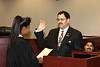 Superior Court Judge Karen Robinson, the first Black judge in Orange County, swears in Bobby McDonald to the Board of Governors of the California Community Colleges