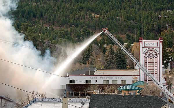 """A view of the Theatre Mall fire from """"The Knoll"""" as firefighters attack the fire and residents gather to view the situation in Estes Park on Monday morning.<br /> Photo by Norman Smith"""