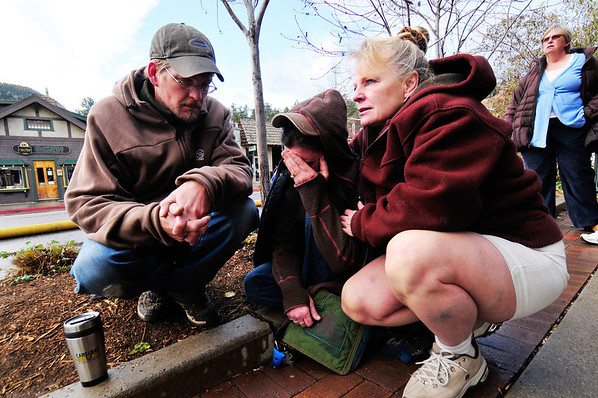 "21EP News Human Toll.jpg Photo by Walt Hester<br /> Shop owners Justin Riedesel, left and Jerri Paulson, right, try to console Michelle Riedesel along Elkhorn Avenue on Monday morning. ""It's just stuff, it's our livelihoods, but it's just stuff"" said Paulson"