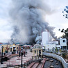 21EP News Fire 2.jpg Photo by Walt Hester<br /> Smoke billows into the morning sky above Estes Park as firefighters from as far away as Boulder attempt to dowse the flames of the Park Theater Mall on Monday.