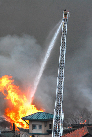 21EP News Fire Loveland FD.jpg Photo by Walt Hester<br /> Firefighters from Loveland Fire Department lend a hand and a hook and ladder truck to help save buildings surrounding the Park Theater Mall on Monday. Help came from all of the surrounding communities and calls went out to as far away as Boulder.
