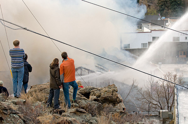 "A view of the Theatre Mall fire from ""The Knoll"" as firefighters attack the fire and residents gather to view the situation in Estes Park on Monday morning.<br /> Photo by Norman Smith"