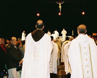 Prests file to altar on Sunday